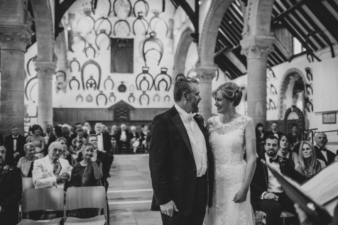 Bride and groom during wedding ceremony at Oakham Castle